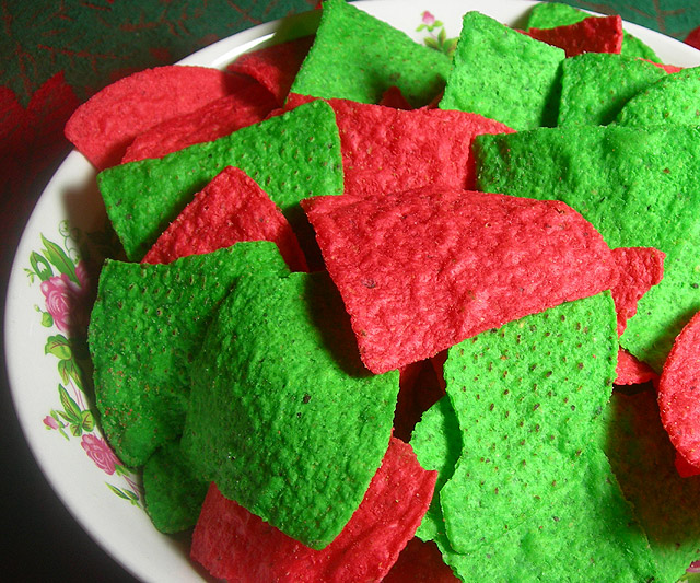 the tortilla chips really are that red and that green they taste no better than white tortilla chips but eating them is like finally satisfying that